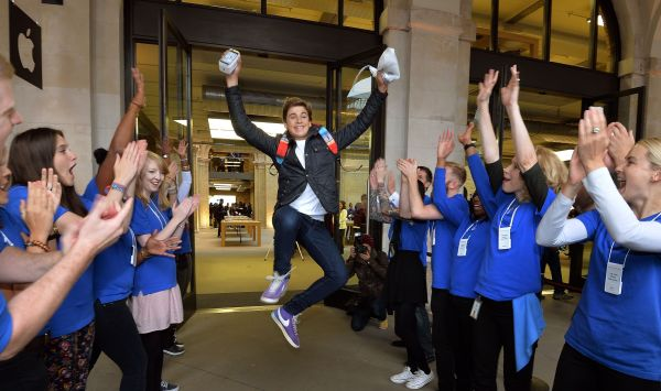 Jesse Green aged 15, from Stanmore jumps for joy as Apple workers applaud him, after being one of the first customers to buy the two new iPhones, at the Apple shop in Covent Garden in central London. PRESS ASSOCIATION Photo. Picture date: Friday September 20, 2013. See PA story TECHNOLOGY Apple. Photo credit should read: John Stillwell/PA Wire