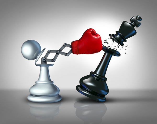 Secret weapon business concept with a chess pawn punching and destroying the competition king piece with a hidden red boxing glove as a metaphor for innovative corporate strategy and planning to win the game.